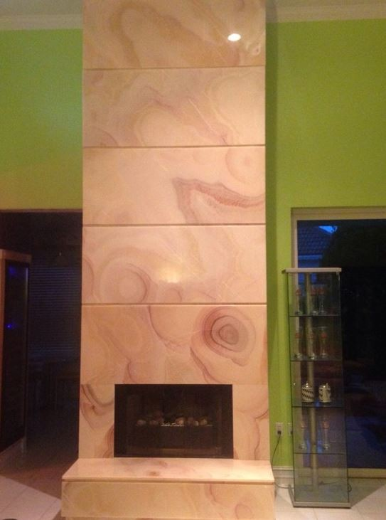 Bluewater Bay - Fireplace in Honey Onyx